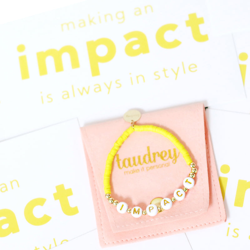 taudrey impact collab bracelet yellow beads gold beads letter block beads impact book shes the first organization