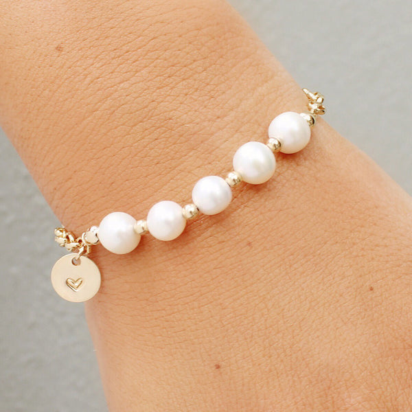 taudrey in a row pearl bracelet with multiple pearls and personalized gold charm