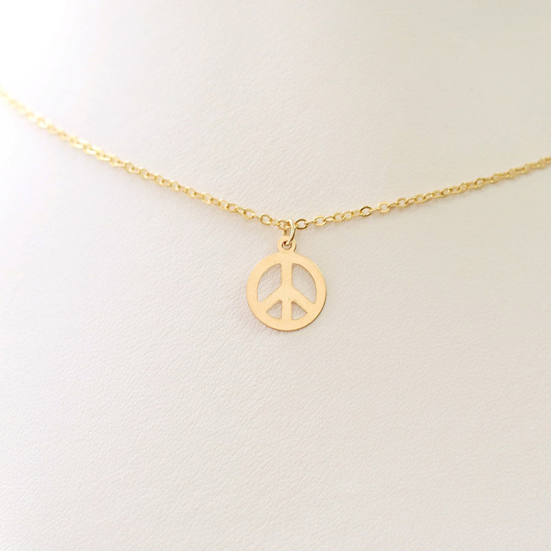 taudrey keep the peace peace sign charm necklace styled