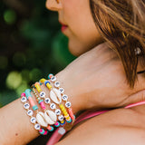 taudrey collab kelly saks playa collection bright beaded bracelets shell details personalized charms