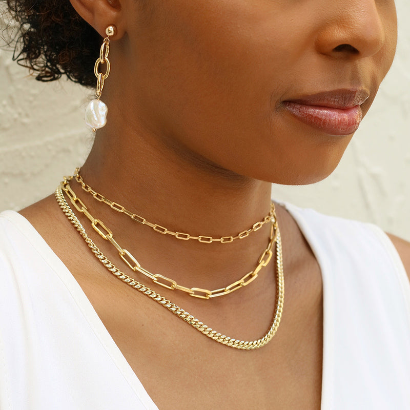 taudrey bold school gold chain pearl earrings