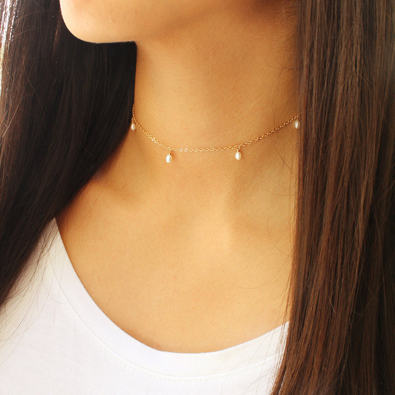 taudrey hanging pearl choker dainty gold mother of pearl details