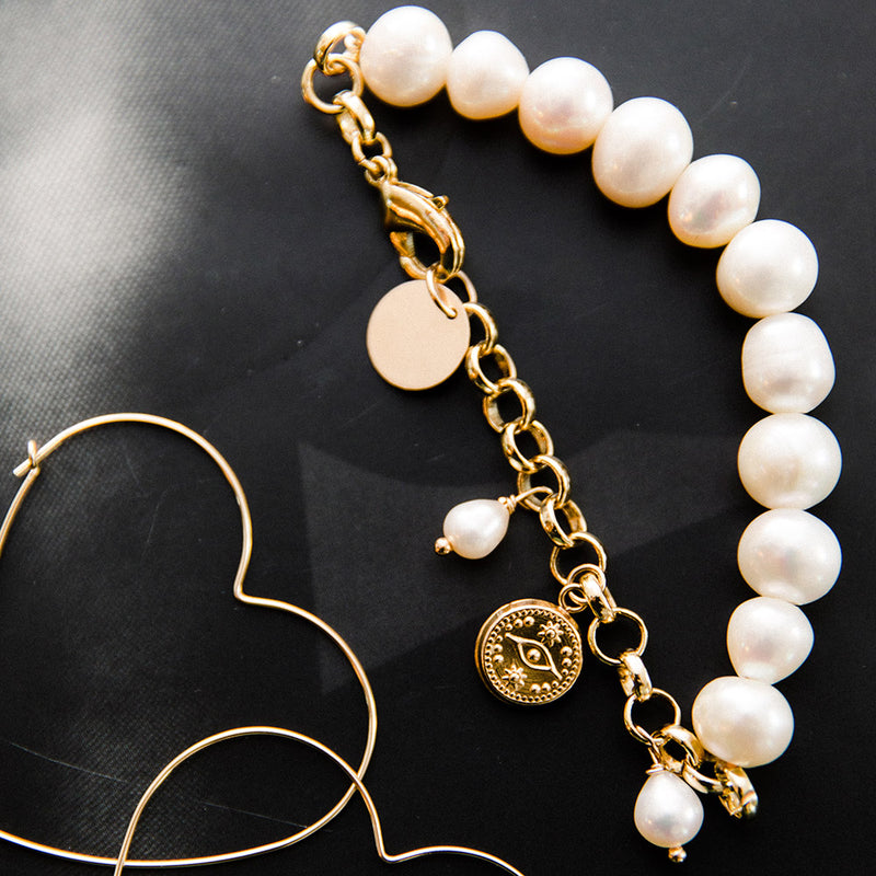 taudrey kelly saks collab libra bracelet chunky pearls hanging pearls gold evil eye medallion
