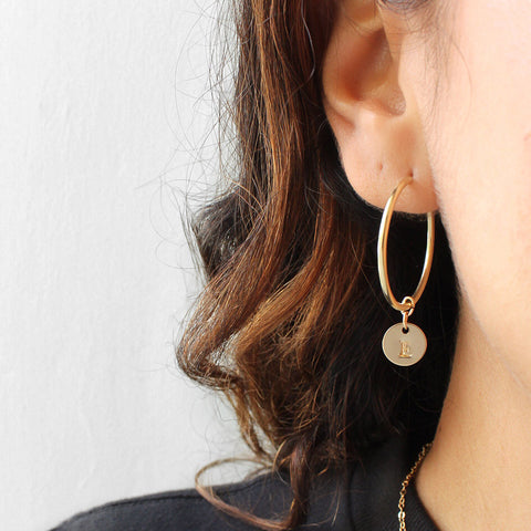 taudrey small gold dainty hoop earrings continuous closure accented with small personalized gold charm