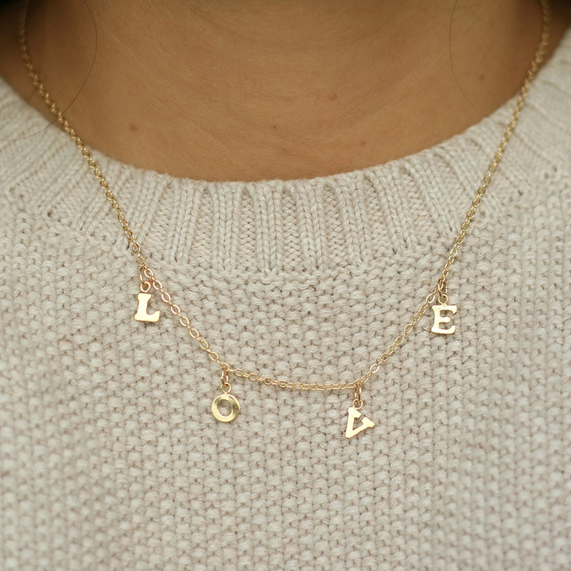 taudrey love on hanging letters adjustable gold filled necklace