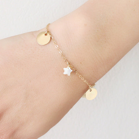 taudrey moonwalk bracelet dainty gold bracelet with hanging gold personalized charms and star shaped pearl details