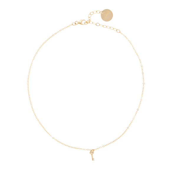taudrey low key gold choker key accent