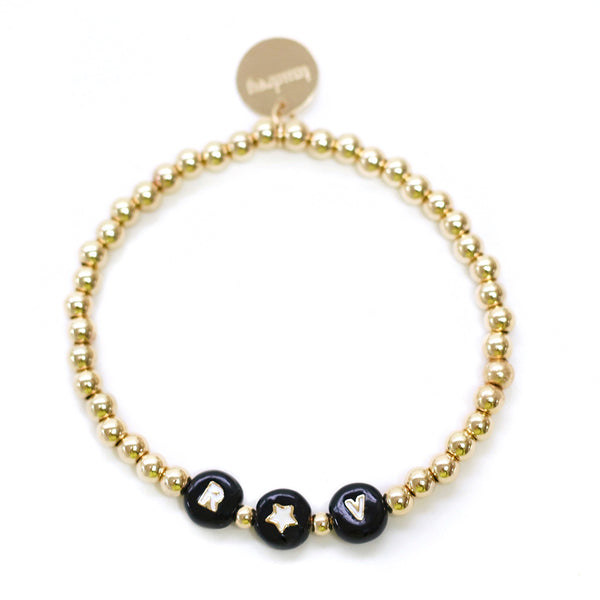 taudrey show and tell bracelet gold outlined black personalized letter beads with gold beads