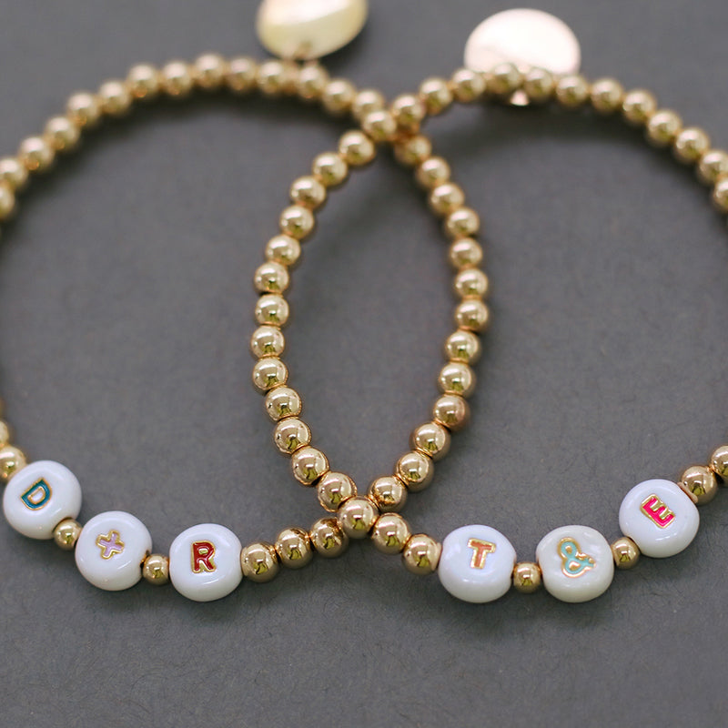 taudrey show and tell bracelet gold outlined colorful rainbow personalized letter beads with gold beads