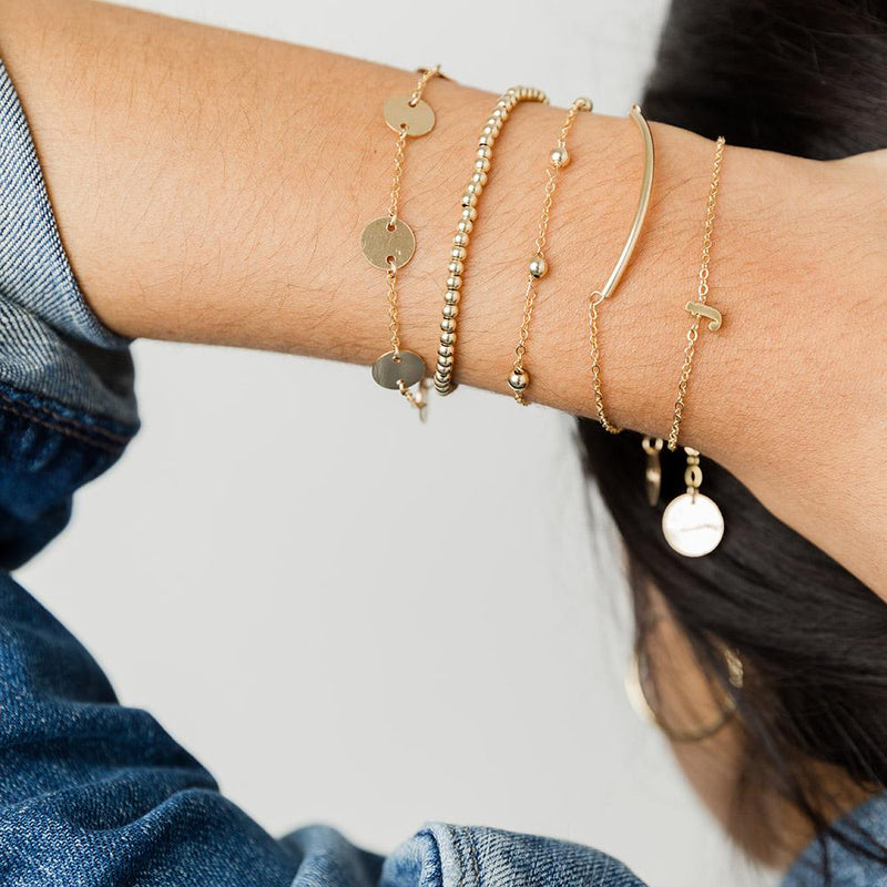 taudrey small print thin chain bracelet gold charm letter accent