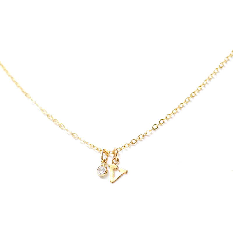 taudrey solo necklace gold letter charm crystal detail