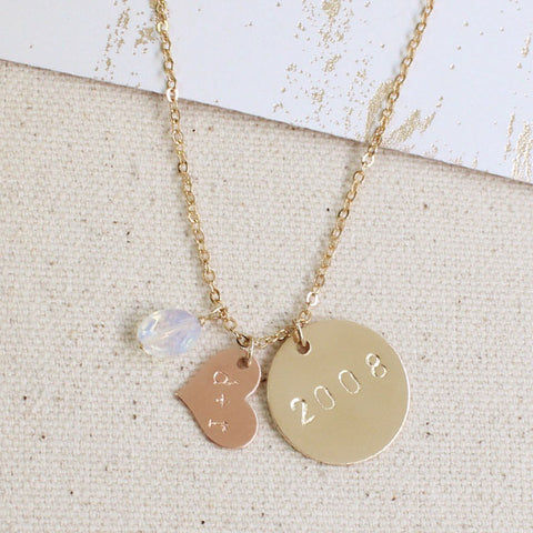 taudrey storyteller necklace with personalized rose heart and gold charm and opal accent