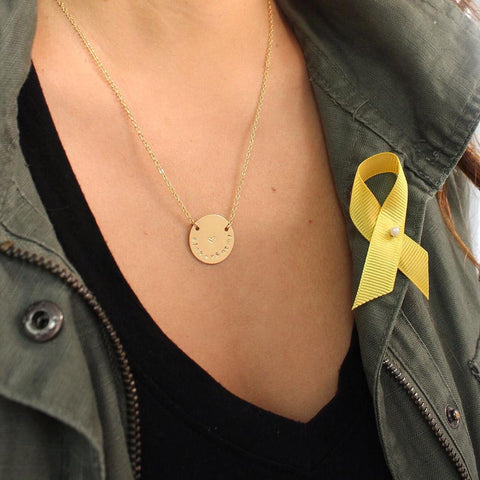 taudrey personalized gold necklace in support of childhood cancer fighter jake jakey duque