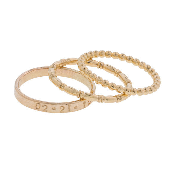 taudrey struck gold ring stack three rings