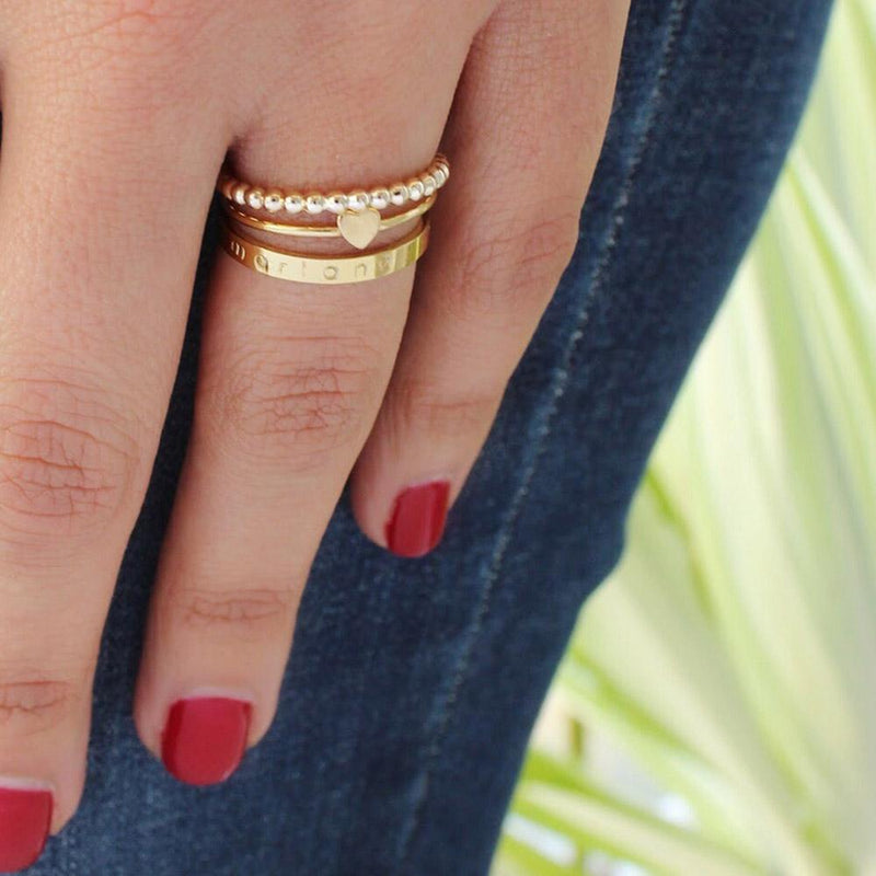 tenley molzahn leopold the bachelor taudrey jewelry collaboration shine collection personalized gold ring stack heart detail mixed textures