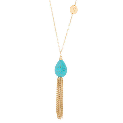 taudrey turqs and tassels necklace gold with turquoise stone gold charm gold tassel