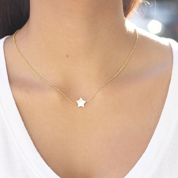 taudrey twinkle necklace gold chain pearl star detail