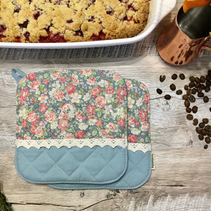 Quilted pot holders in blue and pink