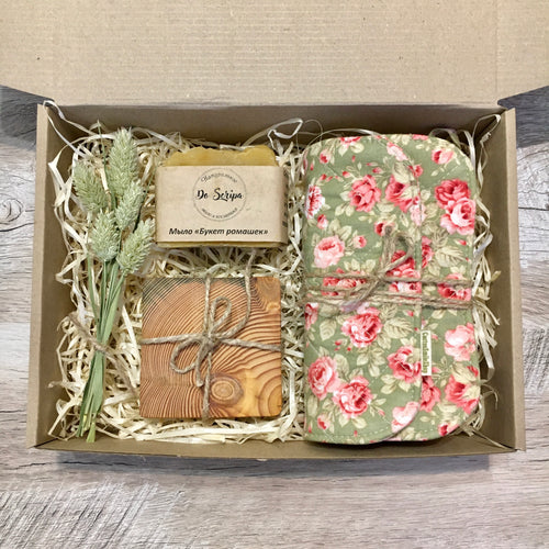 Gift box with potholders, a soap and coasters