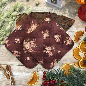 Brown potholders with roses