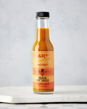 AR's Peach Hot Sauce on Table