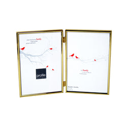 A shiny finish metal double vertical standing photo frame with a thin rounded design in brass