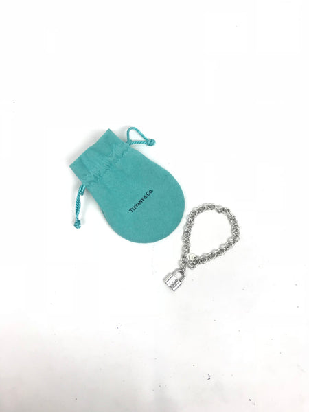 Tiffany and Co. sterling silver lock pendant charm bracelet