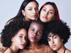 inclusive group of women of color skincare routine
