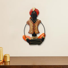 IRMAN515-eCraftIndia-Musician-Tribal-playing-Dholak-Handcrafted-Iron-Wall-Hanging_1