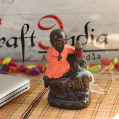 MSBIH103_RD-eCraftIndia-Karate-Style-Monk-Buddha-Smoke-Backflow-Cone-Incense-Holder-Decorative-Showpiece-with-10-free-Smoke-Backflow-Scented-Cone-Incenses_1
