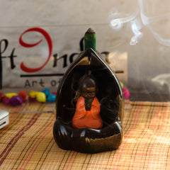 msbih114_rd-ecraftindia-meditating-monk-buddha-smoke-fountain-with-10-backflow-cone-decorative-incense-holder_1