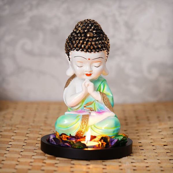 ecraftindia-praying-green-monk-buddha-with-wooden-base,-fragranced-petals-and-tealight_1
