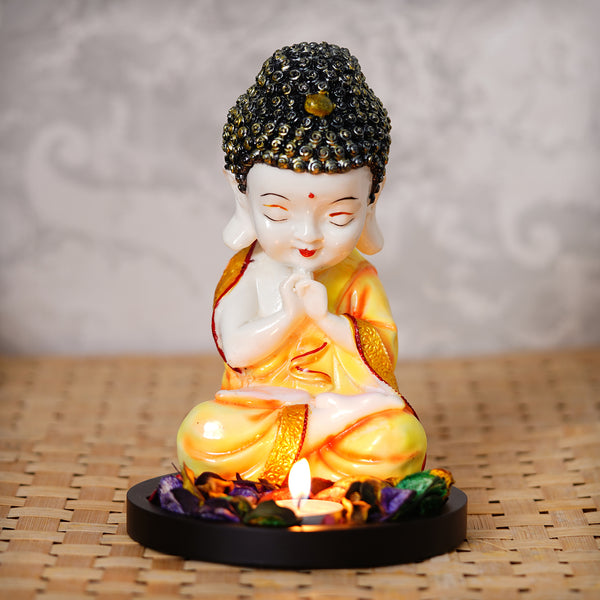 ecraftindia-praying-orange-monk-buddha-with-wooden-base,-fragranced-petals-and-tealight_1