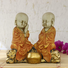 msgb587_or-ecraftindia-set-of-2-orange-monks-polyresin-tealight-holder_1
