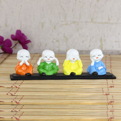 msgb588-ecraftindia-set-of-4-multi-color-monks-polyresin-tealight-holder_1