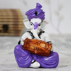 MSGG507_PUR-eCraftIndia-Lord-Ganesha-playing-Dholak_1