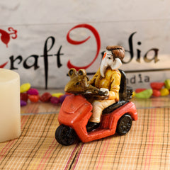 msgg539-ecraftindia-hindu-lord-ganesha-in-scooter-statue-idol-figurine-home-decor_1
