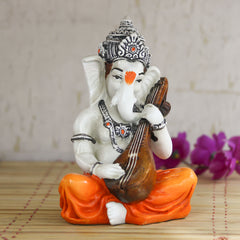 msgg549_big-ecraftindia-lord-ganesha-playing-guitar-decorative-showpiece_1