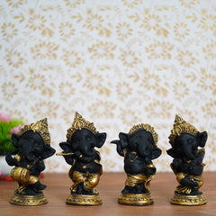 MSGG593-eCraftIndia-Set-of-4-Golden-and-Black-Lord-Ganesha-Dancing-Avatar-Decorative-Showpiece_1