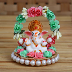 MSGG612-eCraftIndia-Lord-Ganesha-Idol-on-Decorative-Handcrafted-Plate-with-Throne-of-Pink-and-Green-Flowers_1