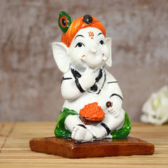 MSGG625-eCraftIndia-Decorative-Lord-Ganesha-eating-Ladoo-in-Lord-Krishna-Avatar_1