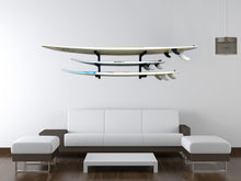 Load image into Gallery viewer, Wall mounted surfboard racks in house powder coated black to hold 3 surfboards