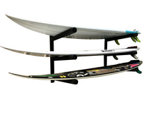 Load image into Gallery viewer, Wall mounted surfboard racks powder coated black to hold 3 surfboards