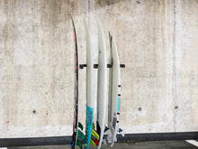 Load image into Gallery viewer, Wall mounted garage vertical surfboard racks powder coated black to hold 4 boards