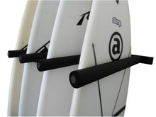 Load image into Gallery viewer, Wall mounted vertical surfboard racks powder coated black to hold 4 boards