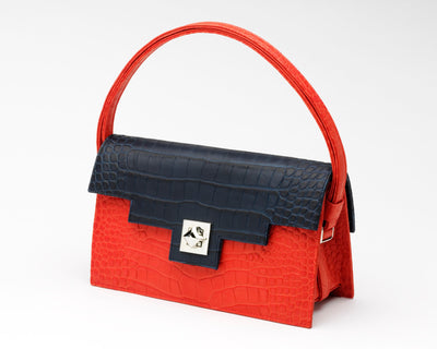Quoin Medium Handbag in red with navy flap