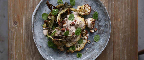 Roast cauliflower steaks, crispy leaves and hazelnut sauce recipe