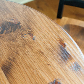 Closeup of hand planed solid pine table top, stained williams pine