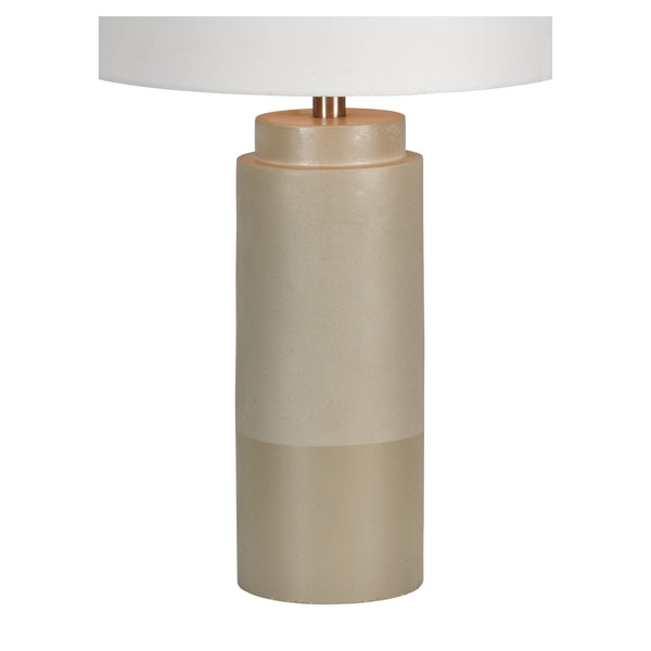 Beige cylinder table lamp with white shade.
