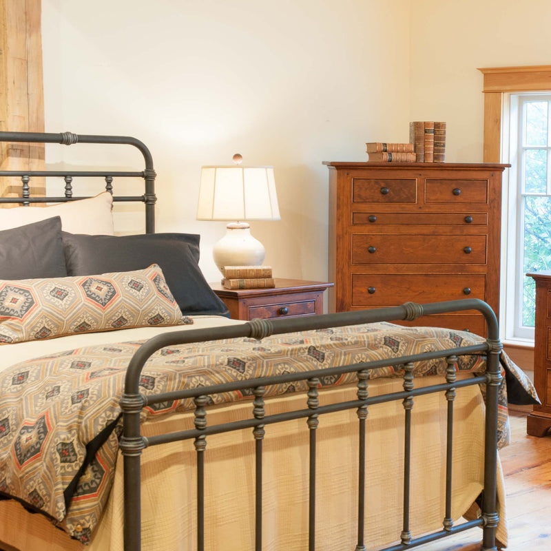 Fairview iron bed with headboard and footboard, angle on view, shown in antique charcoal finish